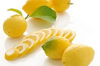 lemon slices and whole lemons on white background