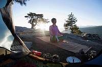 Yoga outside tent at sunrise.