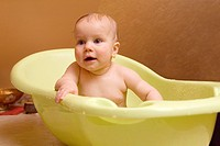 Happy Smiling Eight Month Old Infant Girl Taking Bath in Bathtub