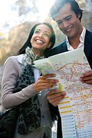 Couple sightseeing together, consulting map