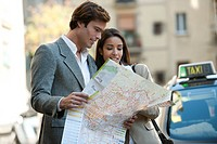 Couple consulting map outdoors