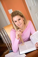 Caucasian college student working on home work