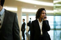 Businesswoman talking on cell phone (thumbnail)