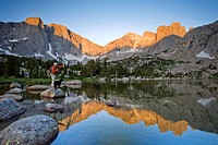 A male fly fisherman in a lake below the Cirque of the Towers, Wind River Range, Wyoming.