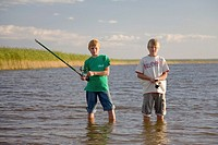Two Teenage Boys Fishing by Lake V&#245;rtsj&#228;rv in Estonia