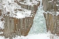 Two people are climbing a frozen waterfall in Sounkyo Gorge, Daisetsuzan National Park, Hokkaido, Japan.