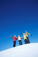 family having fun in ski resort