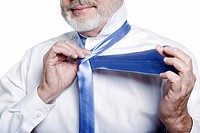 caucasian senior man portrait necktie knot lesson isolated studio on white background