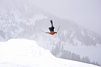 A man backflips off a jump in Wyoming.