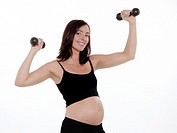 pregnant caucasian woman dumbbells exercise isolated studio on white background