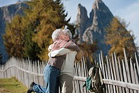 Italy, South Tyrol, Mature couple embracing at dolomites