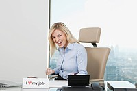 Germany, Frankfurt, Business woman laughing in office