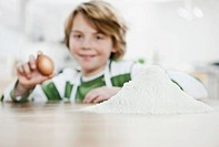 Germany, Cologne, Boy holding egg, portrait