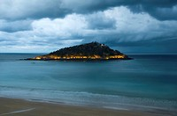 Night view of Santa Clara Island, from La Concha Bay in a cloudy day, Donostia-San Sebastian, Basque Country, Spain, Europe
