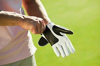 Italy, Kastelruth, Mid adult man wearing golf glove