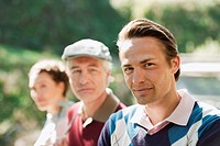 Italy, Kastelruth, Golfers on golf course, portrait