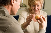 Obsessive_compulsive disorder OCD: a woman undergoing OCD therapy with a doctor, using a half eaten apple to address issues of food and hygiene. NO AD...