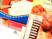 Close_up of packages of food that are free of wheat, gluten, and other ingredients. People may eat foods that are free of certain substances for a var...