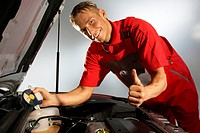 Car mechanic checking cooling water