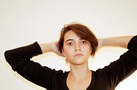 Young woman tying her hair back