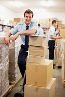 Worker standing near boxes in shipping area