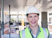 Construction worker smiling on construction site (thumbnail)