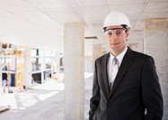 Businessman in hard_hat on construction site