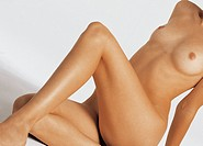 Nude womans body, sitting