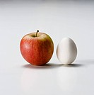 red apple and white egg
