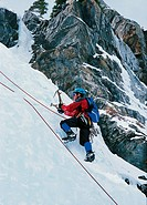 brave climber climbing an ice_covered mountain