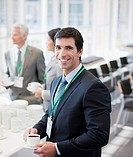 Businessman drinking coffee in office