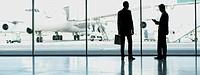 Businessmen standing in airport
