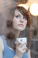 Women behind Rainy Window with Cup