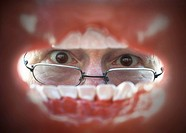 Dentist looking into mouth, seen from inside