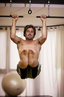 athletic man doing pull_ups