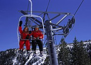 skiers sitting in a chairlift