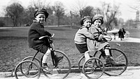 children riding bicycles in a park