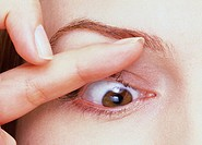 close_up of optician examining an eye