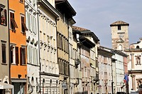 Historical buildings follow along main street of Trento, Trentino, Italy.