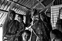 A family at their home aftermath of a devastating cyclone The cyclone Aila swept over the coastal areas of Bangladesh on May 25, 2009 causing severe d...