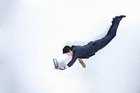 businessman doing work using laptop