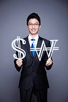 businessman holding dollar and Korean Won sign