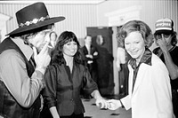 First Lady Rosalynn Carter with Waylon Jennings, smoking a cigarette, and Jesse Colter at a reception preceding a concert to benefit the Carter_Mondal...