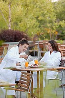 Couple enjoying breakfast on outdoor patio
