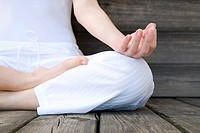 Women in lotus position during yoga (thumbnail)