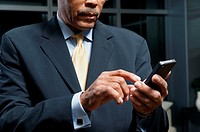 Black businessman using cell phone