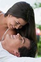 Smiling Hispanic couple looking at each other
