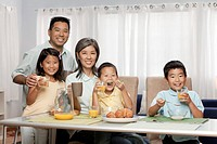 Asian family enjoying breakfast together