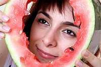 Woman eating a watermelon slice.