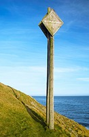 An old sign indicating where telegraph cables are located as they enter the sea to cross the Irish Sea over to the UK, Howth, Co  Dublin, Ireland